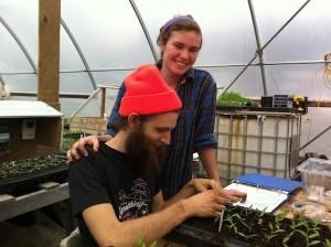 Natalie and Caleb potting up tomatoes in the greenhouse / Natalie et Caleb repiquent les tomates dans la serre